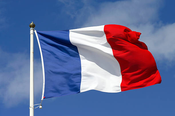 French flag blowing in the wind.
